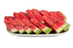 Sliced watermelon on a large plate. On a white background Royalty Free Stock Photo