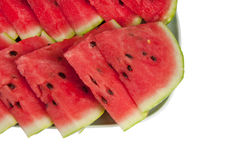 Sliced watermelon on a large plate. On a white background Stock Photo