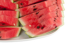 Sliced watermelon on a large plate. On a white background Royalty Free Stock Photography