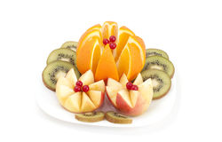 Sliced apples ,orange and kiwi on a white plate.  on a white plate royalty free stock images