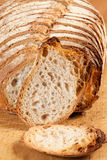 Sliced bread. On a wooden board Royalty Free Stock Images