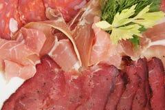 Sliced ham, raw smoked sausage, prosciutto - close-up. stock photos
