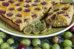 Sliced homemade pie with gooseberries on plate royalty free stock image