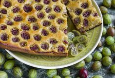 Sliced homemade pie with gooseberries on plate royalty free stock photos