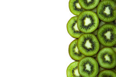 Sliced ​​kiwi slices. On a white background Royalty Free Stock Photo