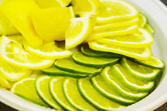Sliced ​​lemon and lime. On a dish Royalty Free Stock Images