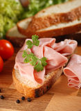 Sliced ��mortadella on wooden chopping board Royalty Free Stock Photos