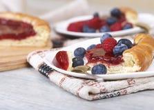 Sliced raspberry cake with fresh berries. Fresh raspberry pie, tasty filling, fresh raspberries and blueberries Stock Photo