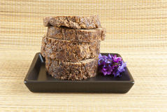 Sliced african black soap with flowers Stock Photography