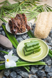 Sliced Aloe Vera leaves on plate, spa elements Royalty Free Stock Photos