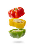 Sliced And Falling Multicolored Peppers Royalty Free Stock Image