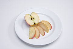Sliced Apple. This is a plate with sliced apples on a white background Royalty Free Stock Photos