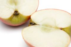 Sliced Apple. Two halves of an apple isolated on a white background Royalty Free Stock Photography