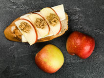 Sliced Apple with Brie Cheese and Walnuts on Toasted Baguette Stock Photography