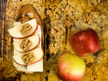 Sliced Apple with Brie Cheese and Walnuts on Toasted Baguette Royalty Free Stock Photos