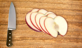 Sliced apple fruit and knife on cutting board Royalty Free Stock Photography