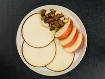 Sliced Apple and Gouda Cheese Rounds. Against a Black Background Royalty Free Stock Image