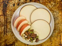 Sliced Apple and Gouda Cheese Rounds. Sitting on an Oven Tray Royalty Free Stock Photography
