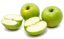 Apple Granny Smith. Sliced apple Granny Smith, two whole and two halves, isolated on white background n Stock Images