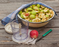 Sliced apple jam in a bowl next to the mixer Stock Photos
