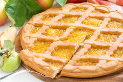 Sliced apple pie on white table Stock Photo