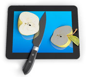 Sliced and apple and tablet. Sliced and apple with a knife on a unrecognizable Tablet PC (3d concept Royalty Free Stock Photography