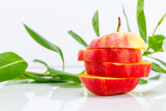 Sliced apple with vegetable juice and flower Stock Image