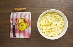 Sliced apples for an apple pie with leftover peel and cinnamon Stock Photo