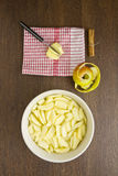 Sliced apples for an apple pie with peel and cinnamon Royalty Free Stock Photos