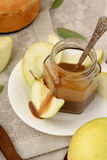 Sliced apples and dipping sauce. Stock Photos