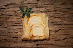 Sliced apples and mint on pastry Royalty Free Stock Images