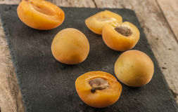 Sliced apricots isolated on black background Royalty Free Stock Images