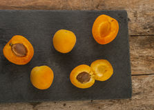 Sliced apricots isolated on black background Stock Images