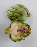 Sliced artichoke on white table Royalty Free Stock Images