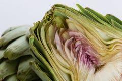 Sliced artichoke on white table Stock Photos