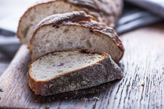 Sliced artisan bread loaf. On wooden board royalty free stock photography