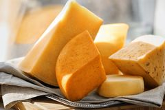 Sliced assorted cheese. On windowsill Stock Images