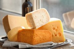 Sliced assorted cheese. On windowsill Royalty Free Stock Photo