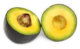 Sliced avacado fruit. Fresh tropical avacado fruit over white background Stock Photos