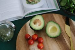 Sliced Avocado on Brown Wooden Board royalty free stock photos