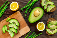 Sliced avocado for homemade sandwiches on kitchen table top view Royalty Free Stock Image