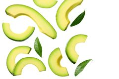 sliced avocado with leaves isolated on white background. top view royalty free stock images