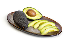 Sliced avocado on a platter Royalty Free Stock Photo