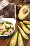Sliced avocado with shrimps in ceramic cocotte Royalty Free Stock Photos