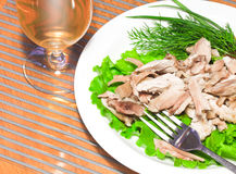 Sliced backed chicken with greens Royalty Free Stock Images