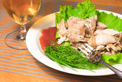 Sliced backed chicken with greens on white plate Royalty Free Stock Photo