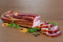 Sliced bacon with caper and parsley  against white Royalty Free Stock Photos