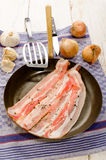 Sliced bacon with crushed peppercorn Royalty Free Stock Image