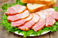 Sliced bacon on a plate. With bread Stock Photo
