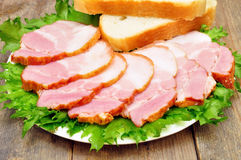 Sliced bacon on a plate. With bread Stock Images